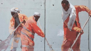Mokamel and his volunteersworked several hours in mornings and evenings, but security concerns halted painting for several days